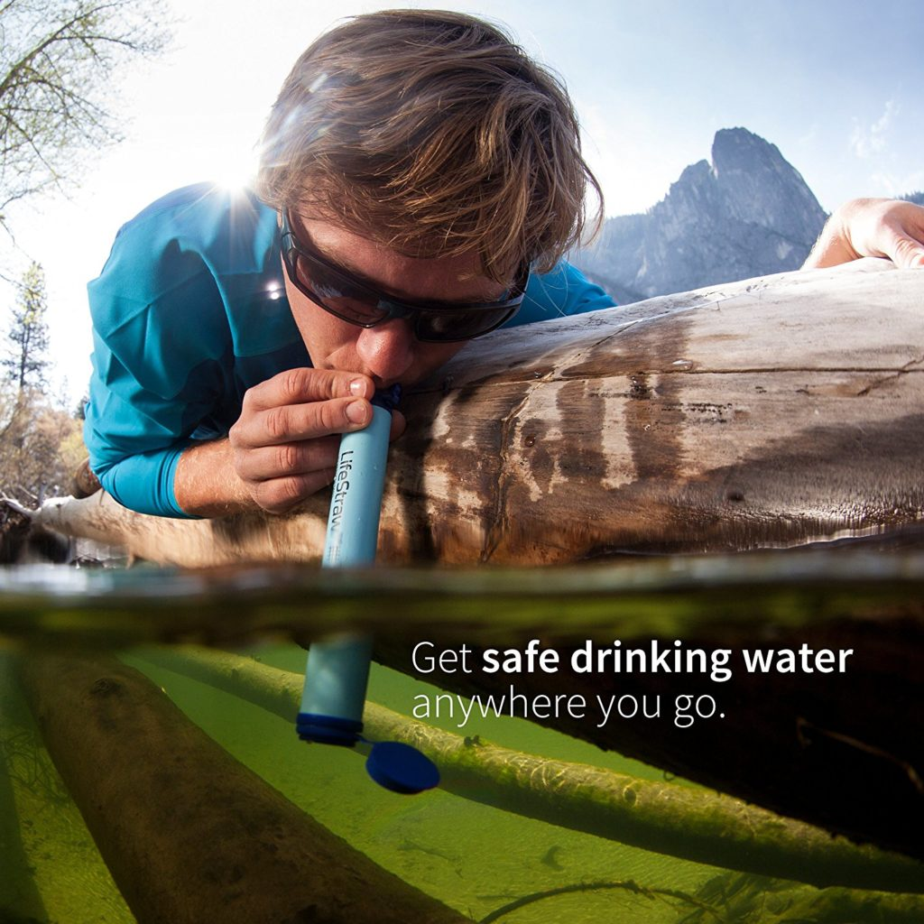 a picture of a man using a life straw